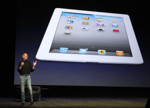 Apple Inc. CEO Steve Jobs introduces the iPad 2 on stage during an Apple event in San Francisco